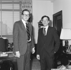 "[""An unknown visitor is photographed with Senator John D. (Jay) Rockefeller in his Washington office.""]%"