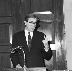 "[""Senator John D. (Jay) Rockefeller speaks at an unknown event in Washington and holds up two fingers in this particular photograph.""]%"
