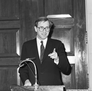 "[""Senator John D. (Jay) Rockefeller smiles and points towards the audience as he speaks at an unknown event in Washington.""]%"