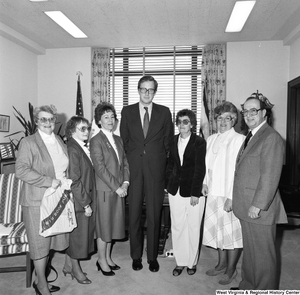 "[""Senator John D. (Jay) Rockefeller stands among representatives from the West Virginia Alliance of Mentally Ill in his office.""]%"