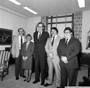 "[""Senator John D. (Jay) Rockefeller greets four unidentified individuals in his office and poses for a photograph with them.""]%"