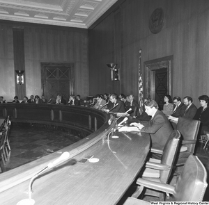 "[""This photograph shows Senators sitting around the table at the back of a committee hearing.""]%"