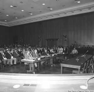 "[""This photograph shows the audience at a committee hearing at the Senate.""]%"