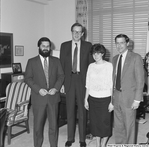"[""Senator John D. (Jay) Rockefeller stands in his office with two doctors from West Virginia and one's daughter.""]%"