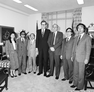 "[""Senator John D. (Jay) Rockefeller stands for a photograph with a large unidentified group in his office.""]%"