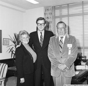 "[""Senator John D. (Jay) Rockefeller stands in front of the desk in his office and stands with two representatives from the National Association of Home Builders. One is unidentified, but the other has a name badge that identifies him as Henry King of Charleston, West Virginia.""]%"