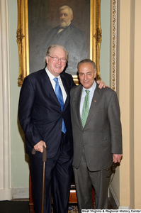 "[""Senators John D. (Jay) Rockefeller and Charles Schumer stand together outside the Senate.""]%"