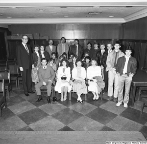 "[""Senator John D. (Jay) Rockefeller stands for a photograph with a large unidentified group in a Senate office building.""]%"