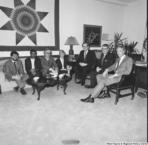 "[""Senator John D. (Jay) Rockefeller sits with members of Capitol Theater Restoration in his Washington office.""]%"