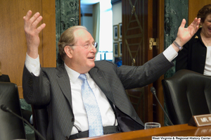 "[""Senator John D. (Jay) Rockefeller holds up his arms during a Senate Finance Committee hearing.""]%"