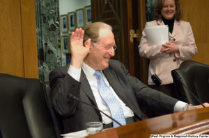 "[""Senator John D. (Jay) Rockefeller raises a hand and laughs during a Senate Finance Committee hearing.""]%"