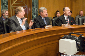 "[""Senator Max Baucus takes his seat as Chairman of the Senate Finance Committee.""]%"