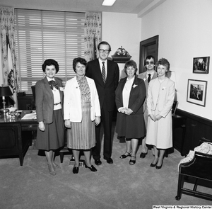 "[""Senator John D. (Jay) Rockefeller poses for a photograph with an unidentified group in his Washington office.""]%"