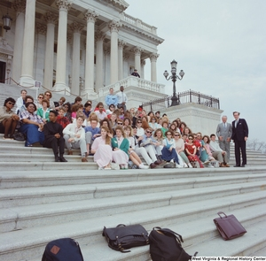 "[""Senator John D. (Jay) Rockefeller stands next to a student group on the steps of the Senate.""]%"