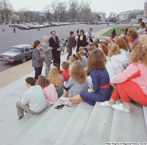 "[""Senators John D. (Jay) Rockefeller and Robert C. Byrd speak to a group of students on the steps of the Senate.""]%"