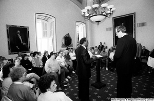 "[""Senator John D. (Jay) Rockefeller prepares to speak with an audience about black lung disease in West Virginia.""]%"