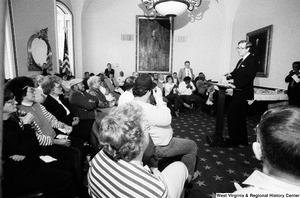 "[""Senator John D. (Jay) Rockefeller talks to a group of West Virginians about black lung disease.""]%"