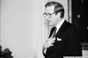 "[""This is a close-up photograph of Senator John D. (Jay) Rockefeller while he speaks to an audience at a Senate building.""]%"