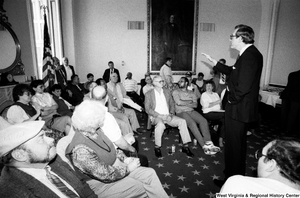 "[""Senator John D. (Jay) Rockefeller answers questions during the discussion portion of a black lung event in the Senate.""]%"