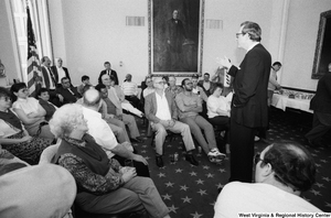 "[""Senator John D. (Jay) Rockefeller answers questions during a discussion with the audience at a black lung event in the Senate.""]%"