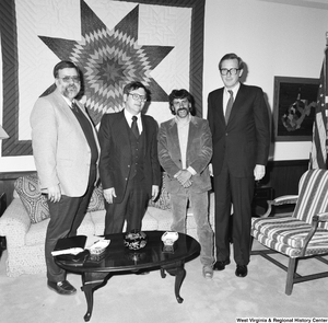 "[""Senator John D. (Jay) Rockefeller stands for a photograph with three unidentified individuals in his Washington office.""]%"