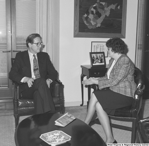 "[""Senator John D. (Jay) Rockefeller listens to an unidentified woman in his office.""]%"