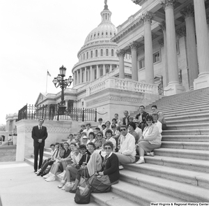 "[""Senator John D. (Jay) Rockefeller stands for a photograph with a large unidentified group that sits on the steps of the Capitol Building.""]%"