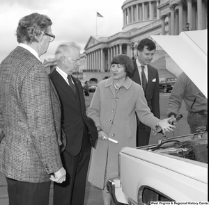 "[""Senator Robert C. Byrd looks at the engine of a car at an alternative motor fuels event outside the Senate.""]%"