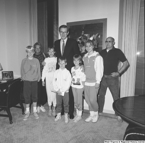 "[""Senator John D. (Jay) Rockefeller stands with a family in his office.""]%"