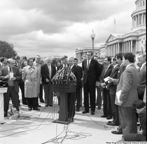 "[""Senator Robert C. Byrd speaks at an event outside the Senate.""]%"