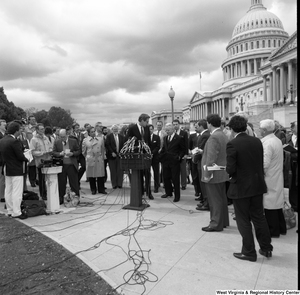 "[""Senator John D. (Jay) Rockefeller stands next to Senator Robert C. Byrd and speaks at an event outside the Senate building.""]%"
