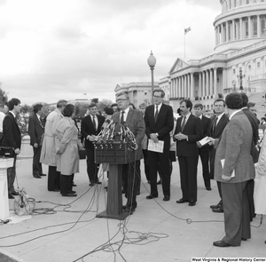 "[""A man speaks to the press at an event outside the Senate building.""]%"