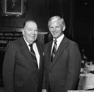 "[""West Virginia University President Neil S. Bucklew and former West Virginia Senator Jennings Randolph stand for a photograph at a WVU Alumni Association event in Washington.""]%"