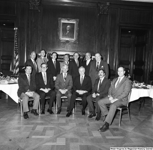 "[""The group attending the West Virginia University Alumni Association event in Washington, including Congressman Nick Rahall, Senator John D. (Jay) Rockefeller, WVU President Neil S. Bucklew, and Senator Robert C. Byrd, gather for a photograph.""]%"