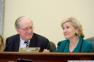 "[""Senators John D. (Jay) Rockefeller and Kay Hutchison sit during a Commerce Committee hearing.""]%"