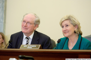 "[""Senators John D. (Jay) Rockefeller and Kay Hutchison smile during a Commerce Committee hearing.""]%"