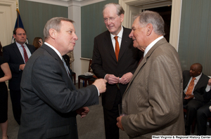 "[""Senators John D. (Jay) Rockefeller and Richard Durbin talk with Bobby Cox.""]%"