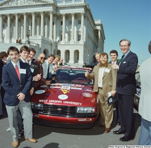 "[""Senator John D. (Jay) Rockefeller stands outside the Senate with members of West Virginia University's ethanol/methanol vehicle team.""]%"
