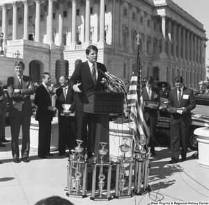"[""Senator Al Gore speaks at a clean vehicle event outside the Senate.""]%"