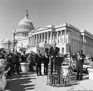 "[""Senator John D. (Jay) Rockefeller speaks at a clean vehicle event outside the Senate.""]%"