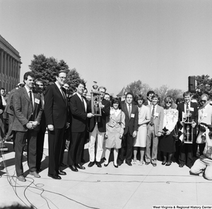 "[""Senator John D. (Jay) Rockefeller and Senator Al Gore stand with the winners of a clean vehicle competition outside the Senate.""]%"