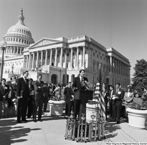 "[""Senator Al Gore stands and speaks to an audience outside the Senate during a clean vehicle event.""]%"