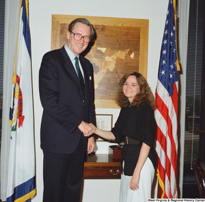 "[""Senator John D. (Jay) Rockefeller shakes hands with a young woman.""]%"
