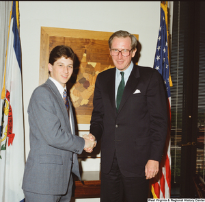 "[""Senator John D. (Jay) Rockefeller shakes hands with a young man.""]%"