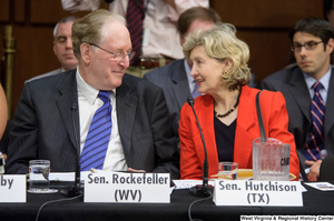 "[""Senators John D. (Jay) Rockefeller and Kay Hutchison sit together at an Environment and Public Works Committee hearing.""]%"