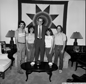 "[""An unidentified group poses for a photograph with Senator John D. (Jay) Rockefeller in his Washington office.""]%"