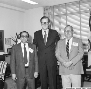 "[""Senator John D. (Jay) Rockefeller stands for a photograph in his office with Joseph A. Caruso and Robert Moore of the National Rural Electric Cooperative Association.""]%"