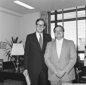 "[""Senator John D. (Jay) Rockefeller stands for a photograph with an unidentified individual in his Washington office.""]%"
