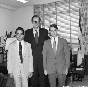 "[""Senator John D. (Jay) Rockefeller stands for a photograph with two unidentified students in his Washington office.""]%"
