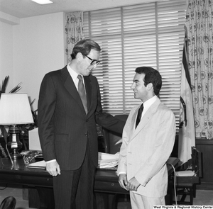"[""Senator John D. (Jay) Rockefeller speaks with an unidentified student in his Washington office.""]%"